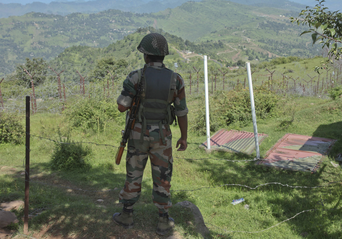 An Indian army soldier guards near fencing on the line of control near Balakot sector in Poonch, Jammu and Kashmir. Despite a