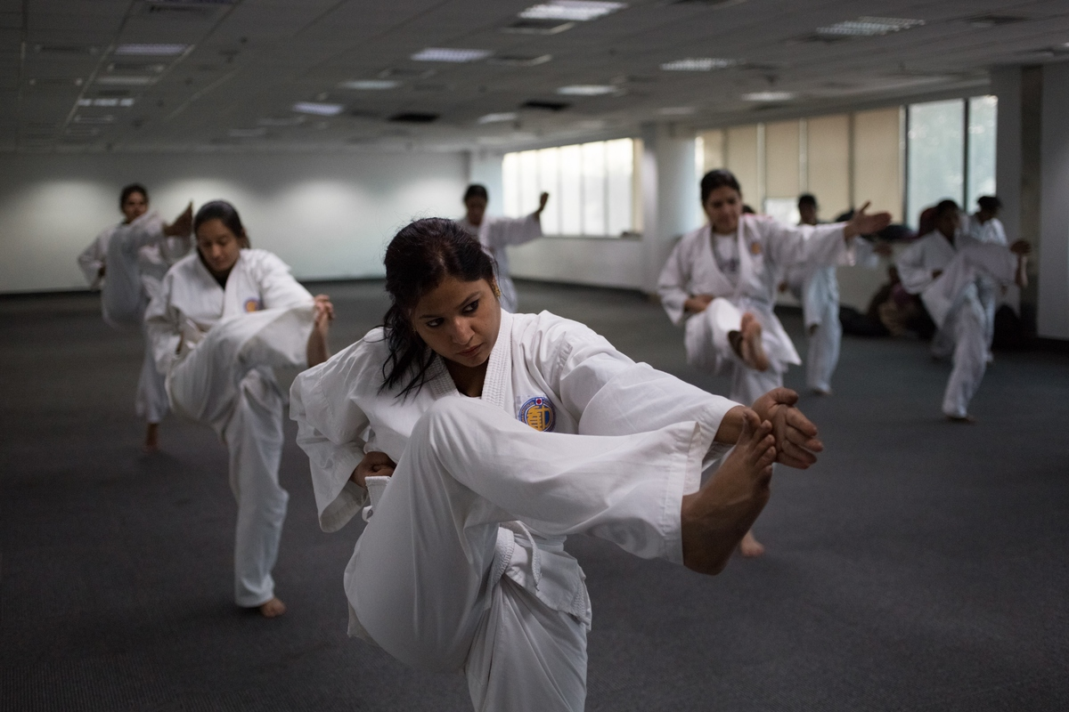 Indian police women practice kicks during a self-defence class in New Delhi.(Photo credit should read Rebecca Conway/AFP/Gett