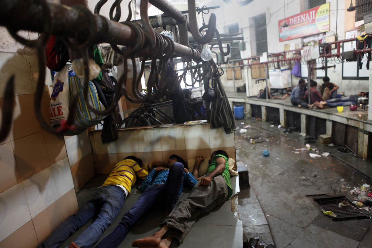 MUMBAI, INDIA - SEPTEMBER 10: Shopkeeper seen sleeping at Crawford meat market on the first day of a four-day ban on the sale