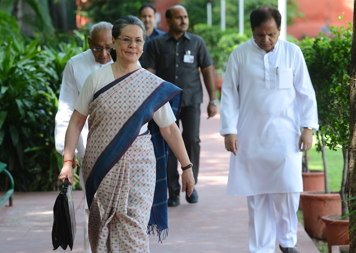 NEW DELHI,INDIA:  Congress President Sonia Gandhi with party leader Motilal Vohra arriving for the CWC meeting at the AICC he