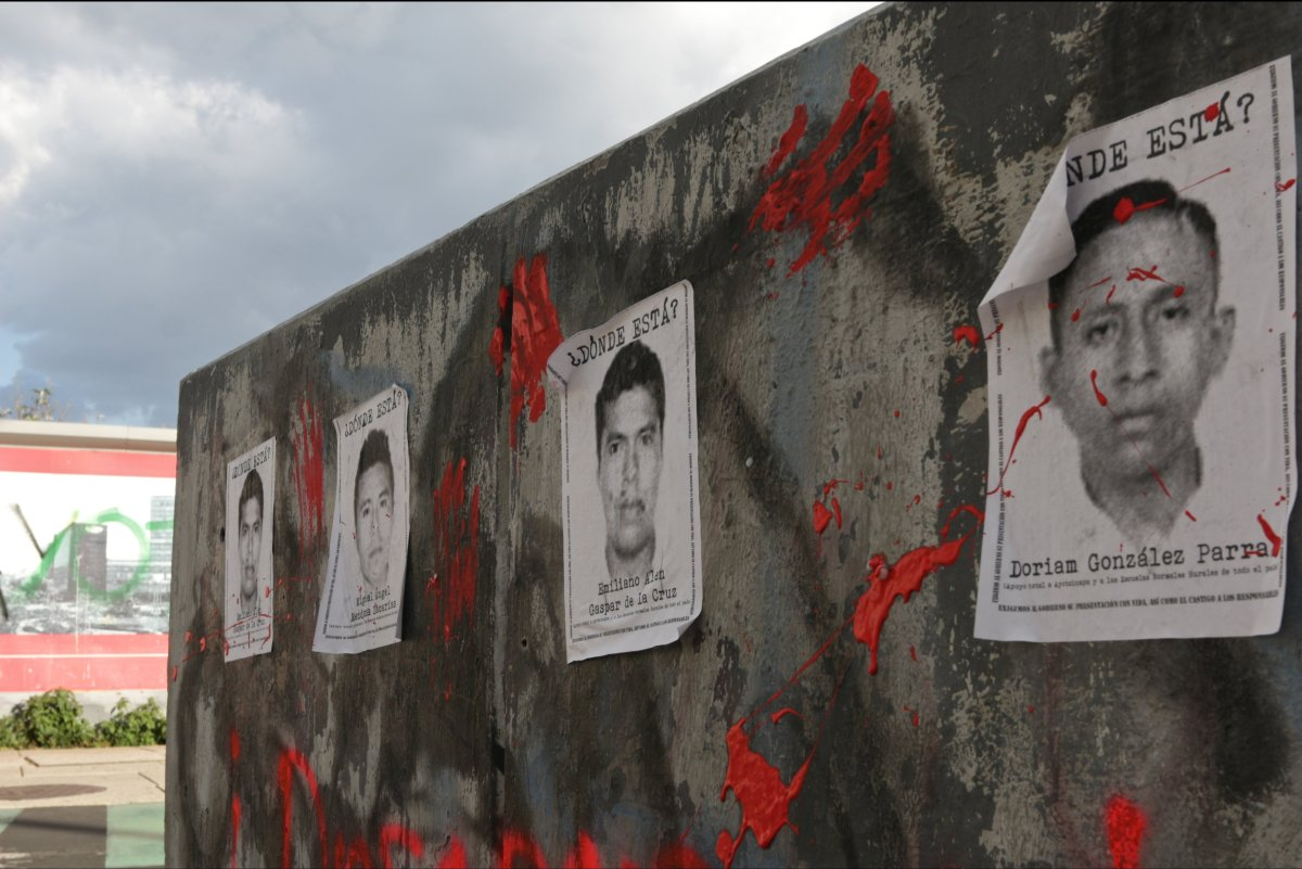 Posters bearing the faces and names of the missing students covered the walls of Downtown Mexico City on Oct. 8.   Photo: San