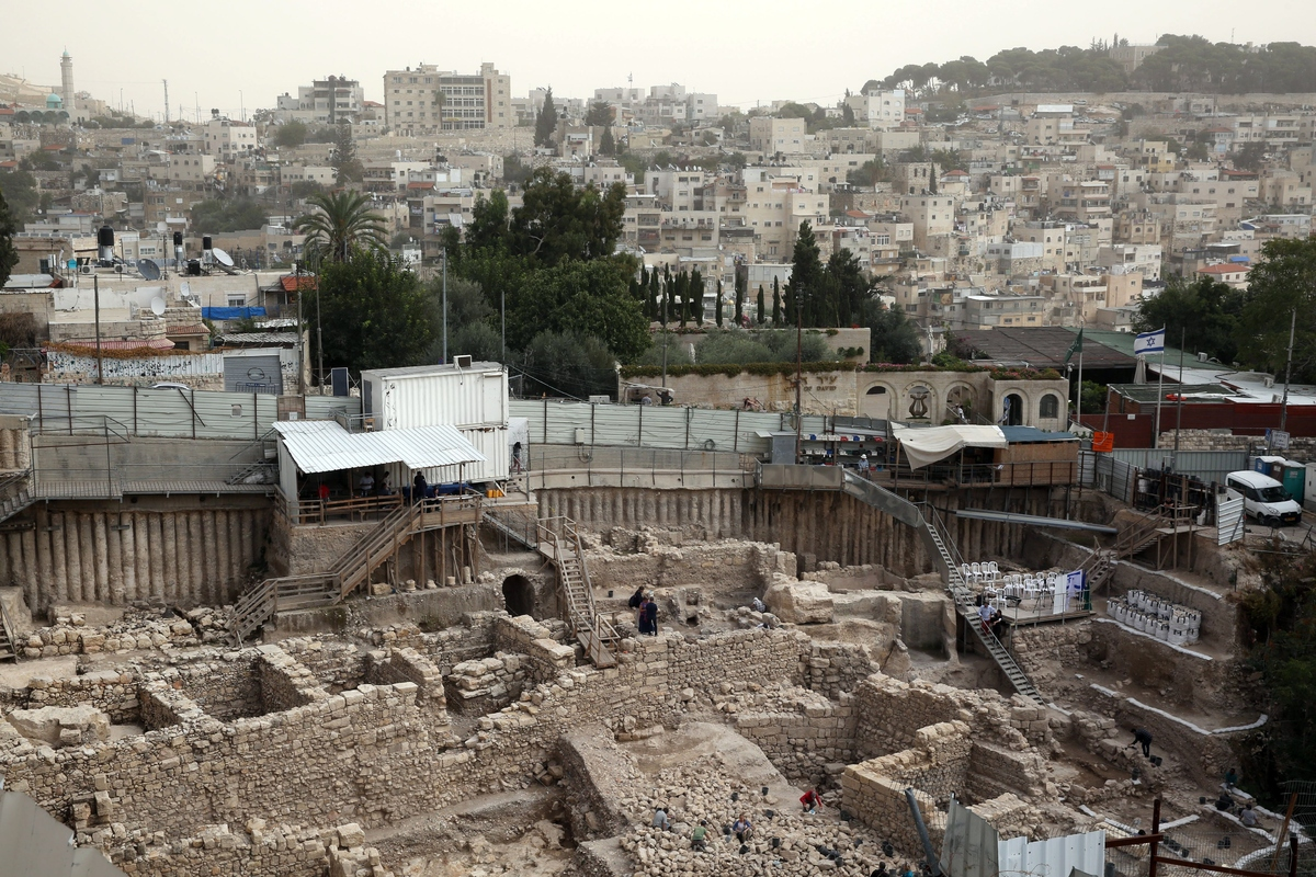 A general view shows workers from the Israeli Antiquity Authorities digging on November 3, 2015 at the excavation site near t