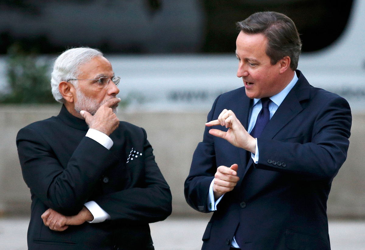 LONDON, UNITED KINGDOM - NOVEMBER 12:  Prime Minister David Cameron and India's Prime Minister Narendra Modi chat after payin