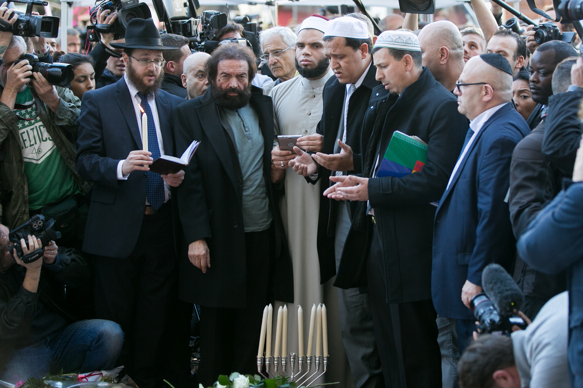 Author Marek Halter (2nd from L), Imam of the Drancy Mosque, Hassen Chalghoumi (4th from L), Imam of one of the Nimes Mosques