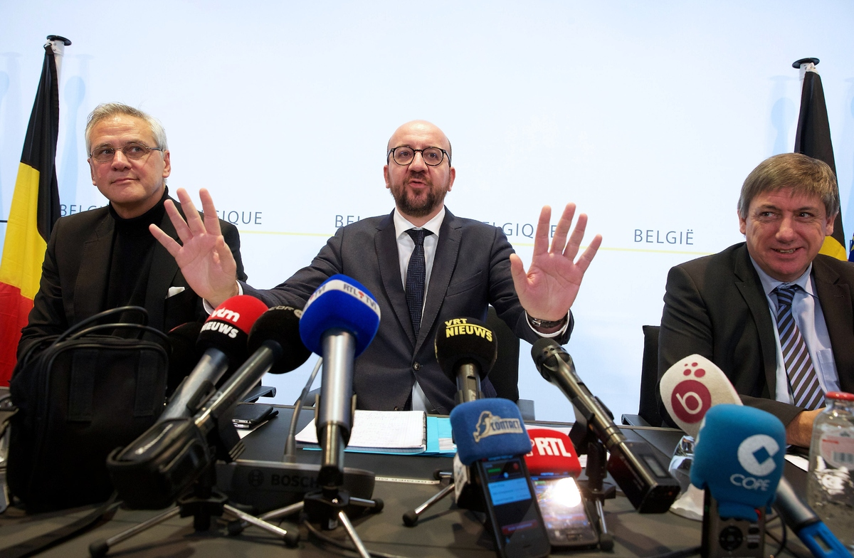 Belgian Prime Minister Charles Michel (C) speaks during a joint press conference with Vice Prime Minister and Minister of Emp