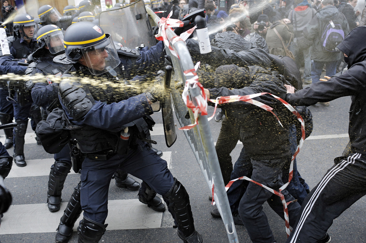 Riot police clashwith protestors following a rally against global warming on Nov. 29, 2015 in Paris, a day ahead of the start