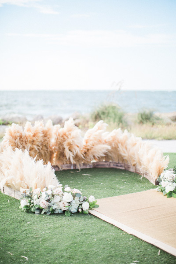 An arch of flowers isn't the only way to dress up a ceremony location. For a recent bride who was wasn't a huge fan of blooms