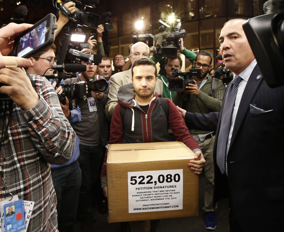 Juan Escalante, campaign manager for the immigration reform group America's Voice, carries a box he claims contains over half