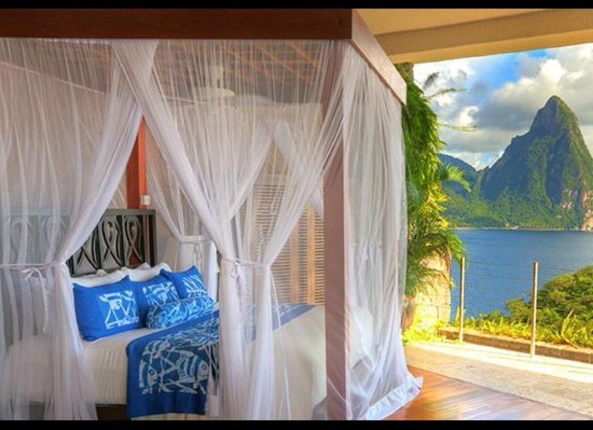 you slide in to your private infinity pool refreshing tropical drink in hand in front of you an view of the pitons tower over the caribbean