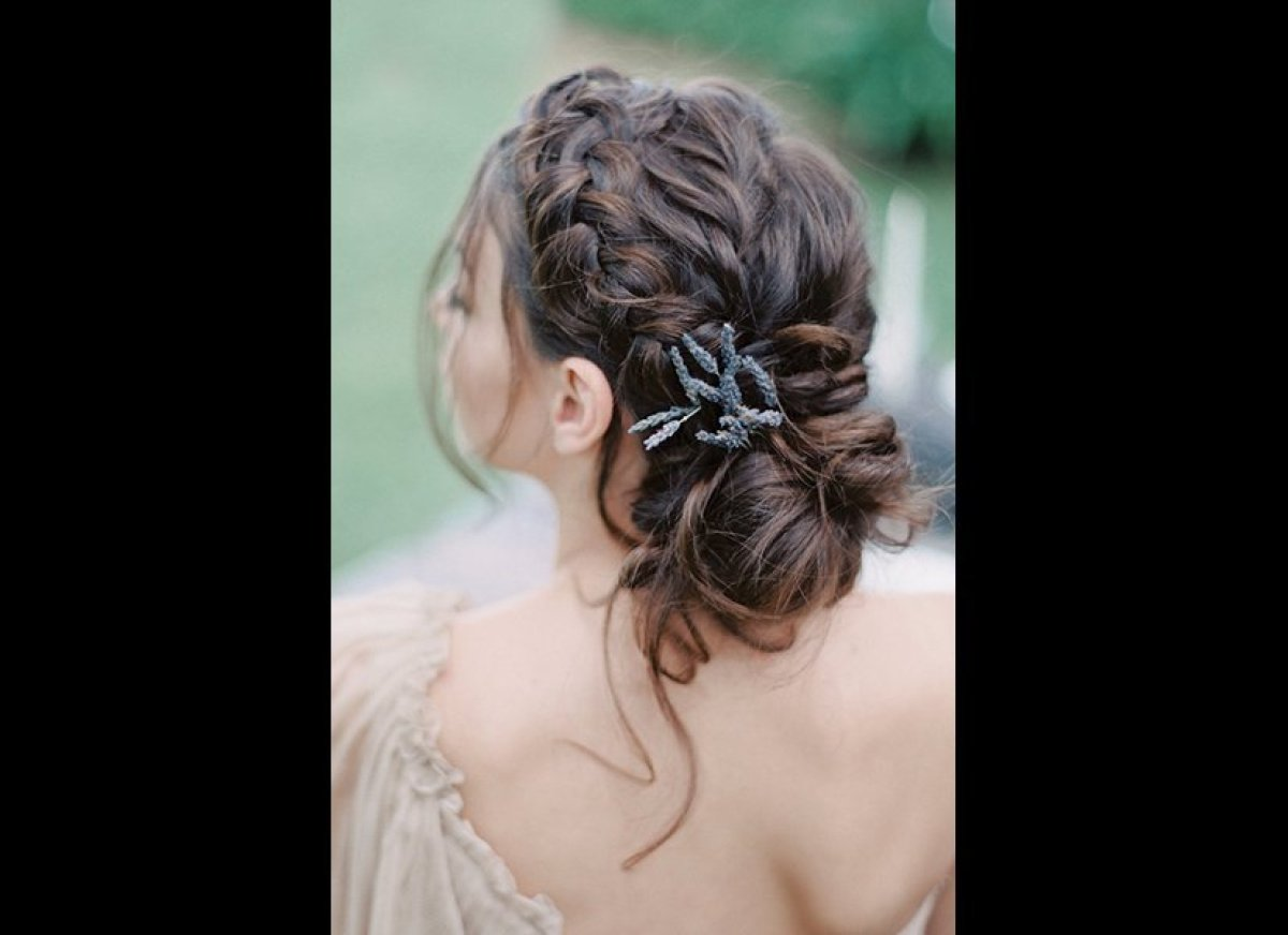 """A thick two-strand braided updo with face-framing tendrils is ultra-romantic.<br><br><em>Photo Credit: <a href=""""http://melani"""