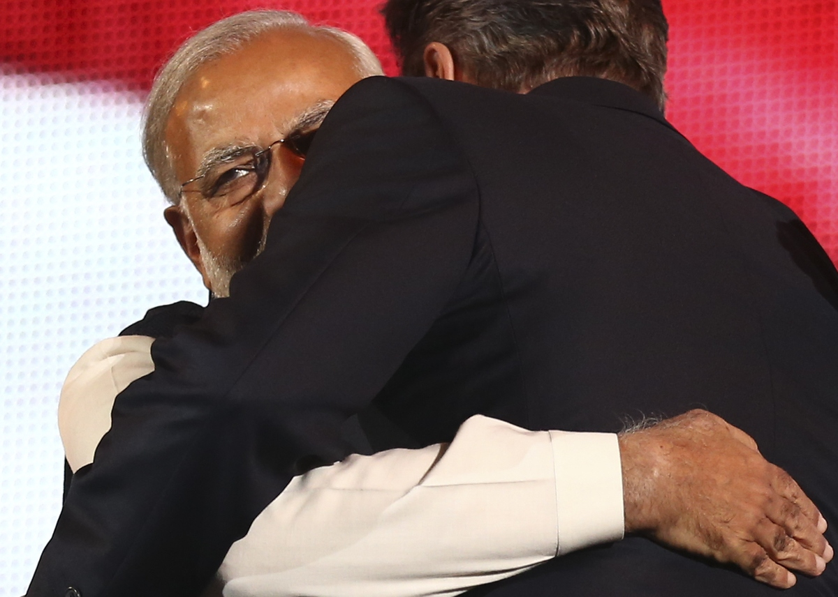 India's Prime Minister Narendra Modi (L) embraces British Prime Minister David Cameron (R).