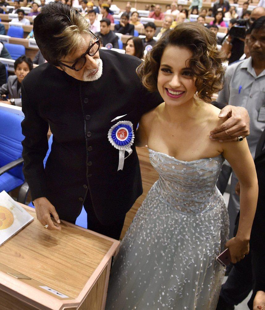 Amitabh Bachchan and Kangana Ranaut pose for cameras at the 63rd National Awards held in Vigyan Bhawan, New Delhi, on May 3,