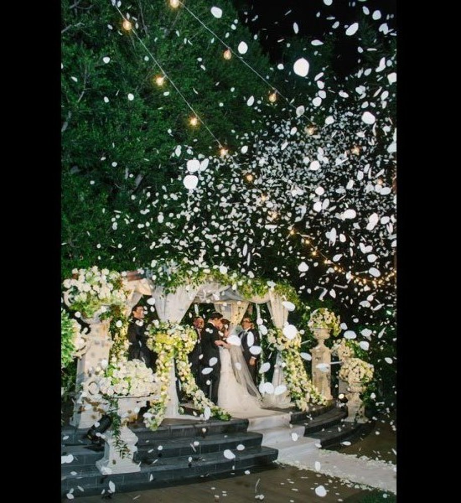 "A shower of flower petals instantly adds romantic grandeur to any kiss.  <strong>Related: <a href=""http://www.bridalguide.com"