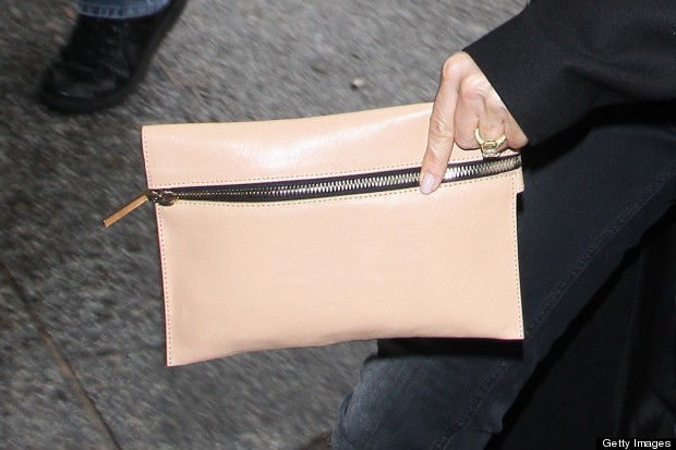 Either Way Victoria Reminded Us That There S Nothing Quite Like A Clutch Bag To Make An Outfit Look Chic Particularly If It In Peach Leather And Has