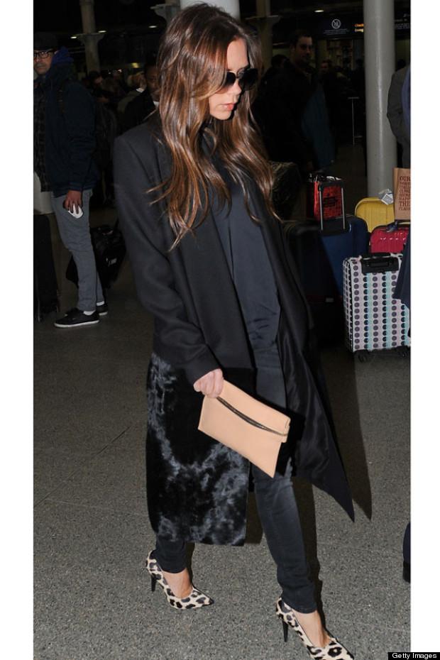 Victoria Beckham Arrives Back In London Makes A Clutch Bag Look Practical