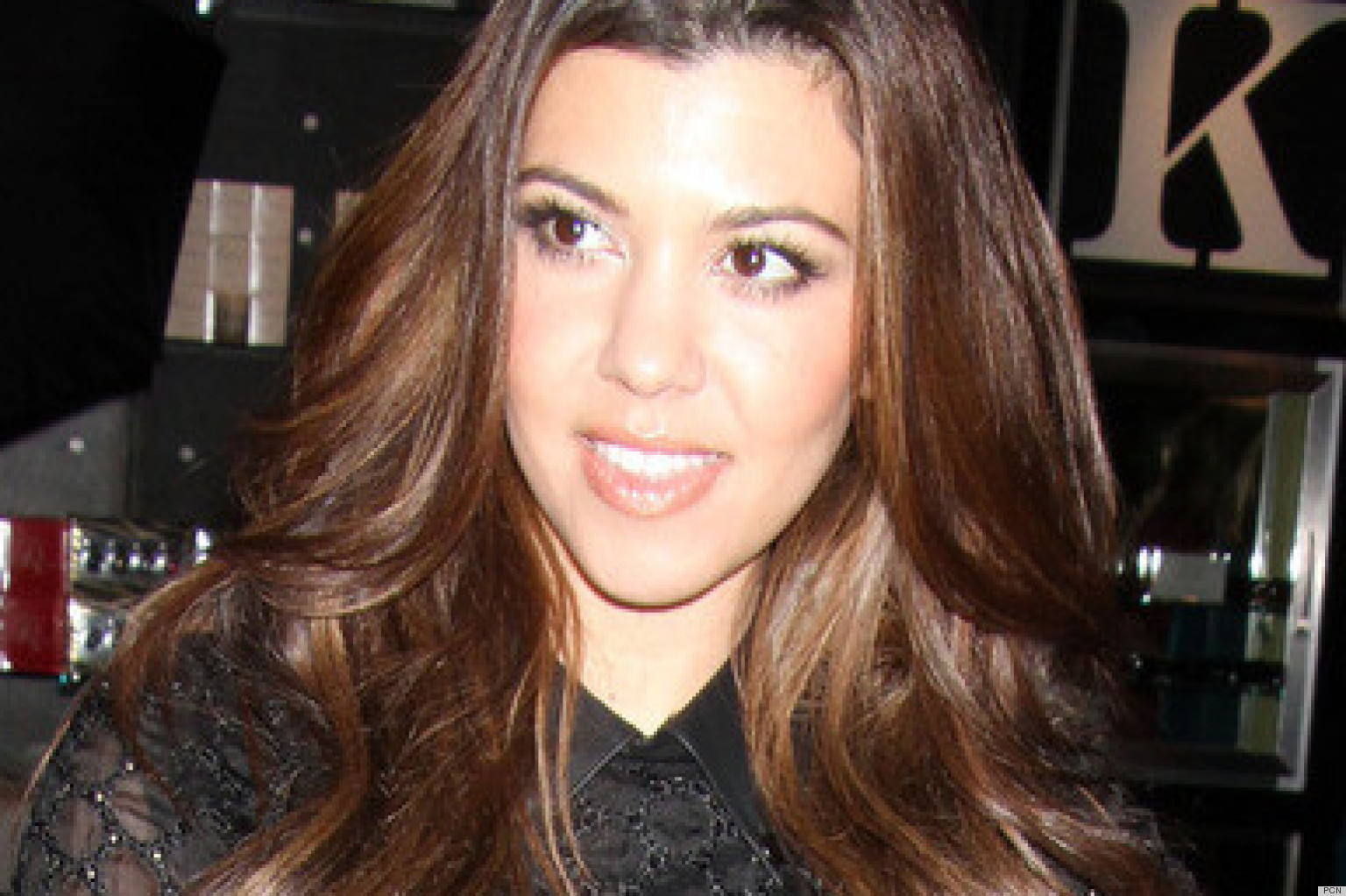 kourtney kardashian's bangs: does she look better than kim? (photo