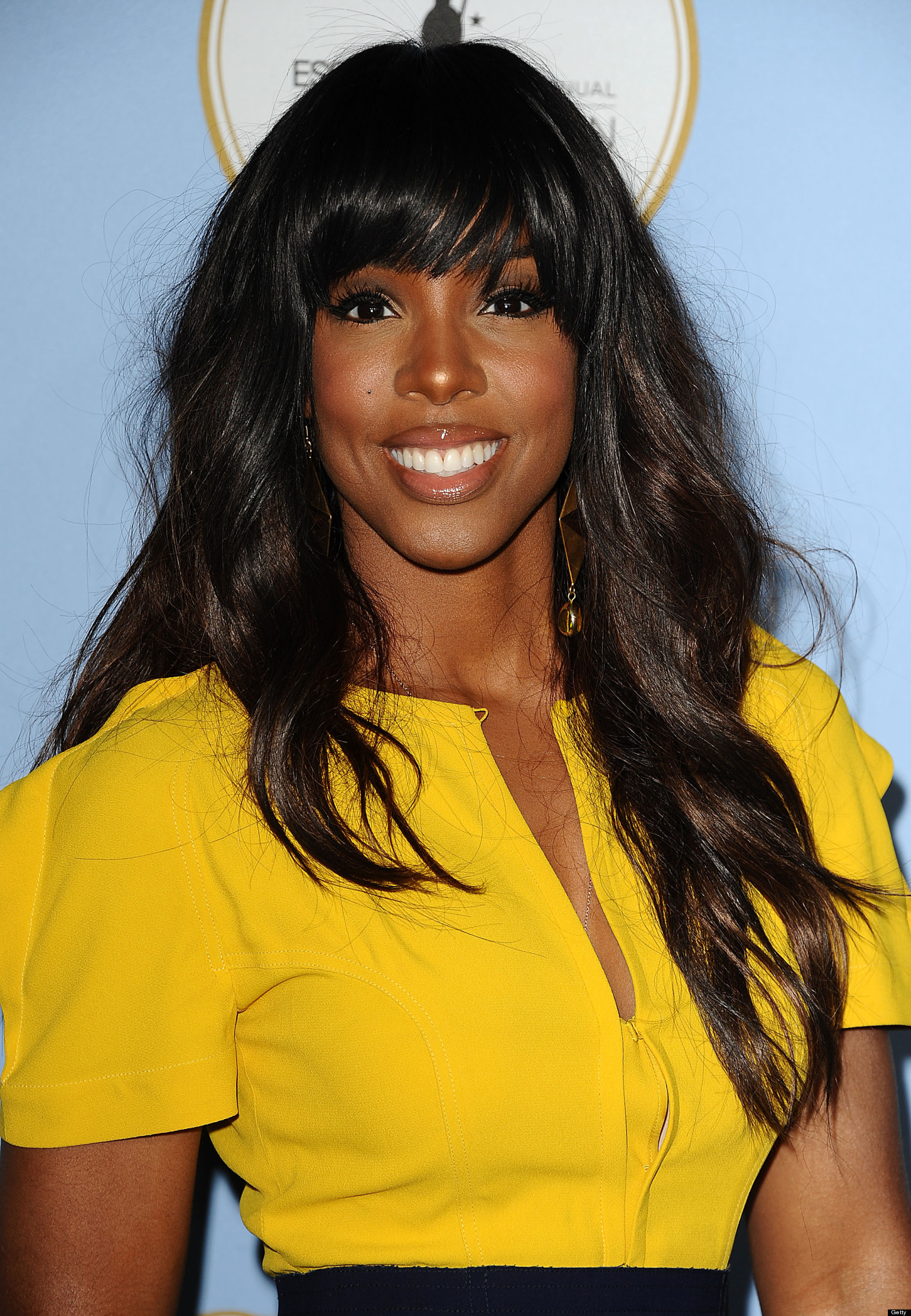 Beauty Brown Hair Woman With Smile On Her Face Royalty: Kelly Rowland Didn't Like Her Dark Skin Color, Says