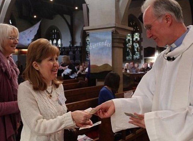 vicar handing out money