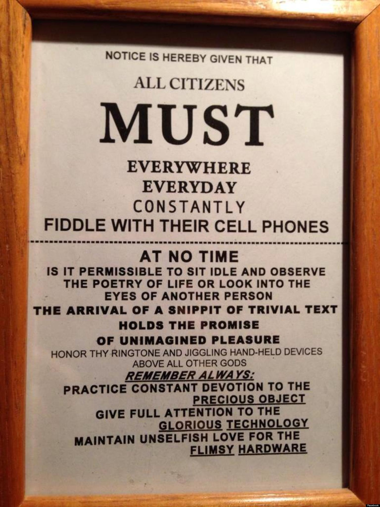 u0026 39 all citizens must fiddle with their cell phones u0026 39  sign