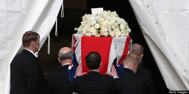 LONDON, ENGLAND - APRIL 16:  The coffin of former Prime Minister Margaret Thatcher arrives at the Houses of Parliament ahead of her funeral on April 16, 2013 in London, England. Lady Thatcher's coffin will rest inside the Chapel Of St Mary Undercroft overnight before a ceremonial funeral service is held at St Paul's Cathedral tomorrow.  (Photo by Peter Macdiarmid/Getty Images)