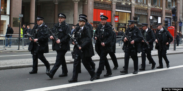 Armed Police walk up the Strand ahead of the funeral of Margaret Thatcher
