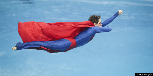 BEIJING, CHINA - MARCH 15:  (CHINA OUT) A diver dressed as Superman performs during day one of the FINA Diving World Series Beijing Station at the National Aquatics Center on March 15, 2013 in Beijing, China.  (Photo by ChinaFotoPress/Getty Images)