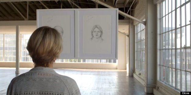 A woman looks at an artist's impressions of her in Dove 'Real Beauty Sketches' Video
