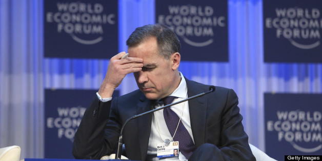 Mark J. Carney, then governor of the central bank of Canada, pauses during a session on the final day of the World Economic Forum