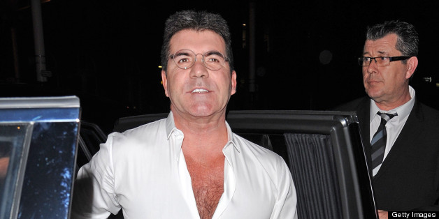 LONDON, UNITED KINGDOM - APRIL 11: Simon Cowell sighting arriving at the My Beautiful Ball fundraiser at the Landmark Hotel on April 11, 2013 in London, England. (Photo by Alan Chapman/FilmMagic)