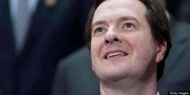 British Cancellor of the Exchequer George Osborne smiles before a family photo of finance ministers and central bank governors following the G20 meeting at the 2013 World Bank/IMF Spring meetings in Washington on April 19, 2013.     AFP PHOTO/Nicholas KAMM        (Photo credit should read NICHOLAS KAMM/AFP/Getty Images)