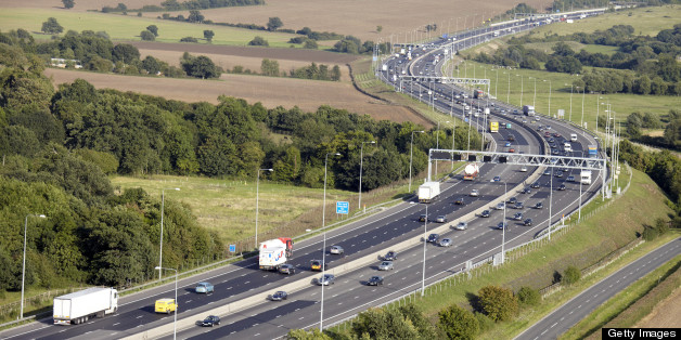 Aerial Photography view east of traffic on M25 Motorway highway north of Stapleford Essex RM4, England UK