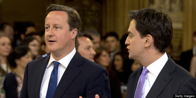 British Prime Minster David Cameron (L) and Ed Miliband, the Leader of the Labour Party, walk through the Members' Lobby to listen to the Queen's Speech at the State Opening of Parliament on May 8, 2013. Heir to the throne Prince Charles and his wife Camilla attended the state opening of Britain's parliament alongside Queen Elizabeth II on Wednesday, in a sign of their increasing role as the 87-year-old monarch scales back some of her duties.   AFP PHOTO / ALASTAIR GRANT/POOL        (Photo credit should read ALASTAIR GRANT/AFP/Getty Images)