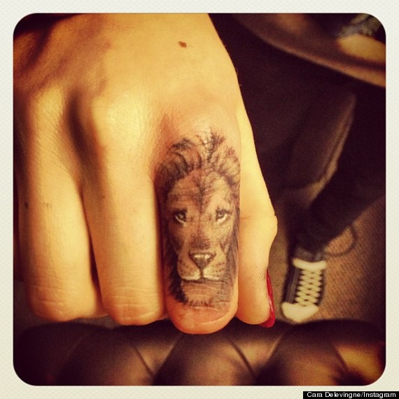 cara delevingne new lion tattoo