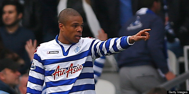 Queens Park Rangers' French striker Loic Remy celebrates after scoring the opening goal of the English Premier League football match between Queens Park Rangers and Wigan Athletic at the Loftus Road Stadium in London on April 7, 2013. The game finished 1-1. AFP PHOTO/ANDREW COWIE  RESTRICTED TO EDITORIAL USE. No use with unauthorized audio, video, data, fixture lists, club/league logos or ?live? services. Online in-match use limited to 45 images, no video emulation. No use in betting, games or single club/league/player publications.        (Photo credit should read ANDREW COWIE/AFP/Getty Images)