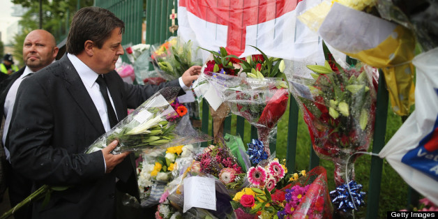 British National Party (BNP) leader Nick Griffin arrives to lay flowers close to the scene where Drummer Lee Rigby of the 2nd Battalion the Royal Regiment of Fusiliers was killed