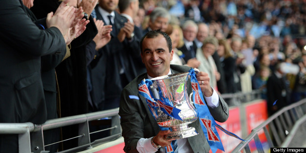 LONDON, ENGLAND - MAY 11:  Wigan Athletic manager Roberto Martinez celebrates with the trophy after victory in the FA Cup with Budweiser Final match between Manchester City and Wigan Athletic at Wembley Stadium on May 11, 2013 in London, England.  (Photo by Michael Regan - The FA/The FA via Getty Images)