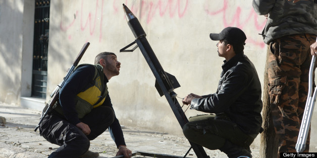 Rebel fighters prepare to launch of a rocket in the Saif al-Dawla district of the northern Syrian city of Aleppo