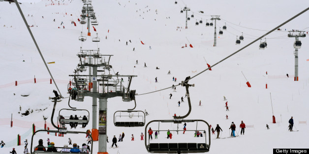 People enjoy the slopes at the French ski resort of Meribel in the French Alps on March 7, 2013.     AFP PHOTO / PHILIPPE DESMAZES        (Photo credit should read PHILIPPE DESMAZES/AFP/Getty Images)
