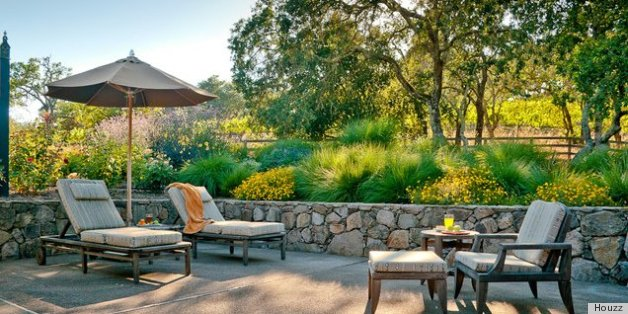 10 rock wall ideas for a style strong patio huffpost