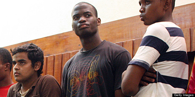Adebolajo (centre) of Romford, Essex, has been remanded in custody