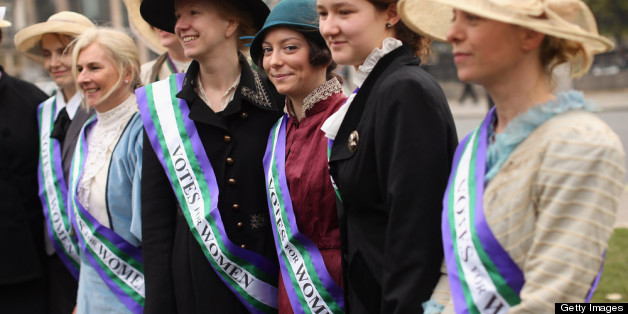 Campaigners dressed as suffragettes attend a rally organised by UK Feminista to call for equal rights for men and women