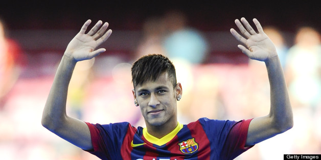 BARCELONA, SPAIN - JUNE 03:  Neymar waves to the crowd during the official presentation as a new player of the FC Barcelona at Camp Nou Stadium on June 3, 2013 in Barcelona, Spain.  (Photo by David Ramos/Getty Images)