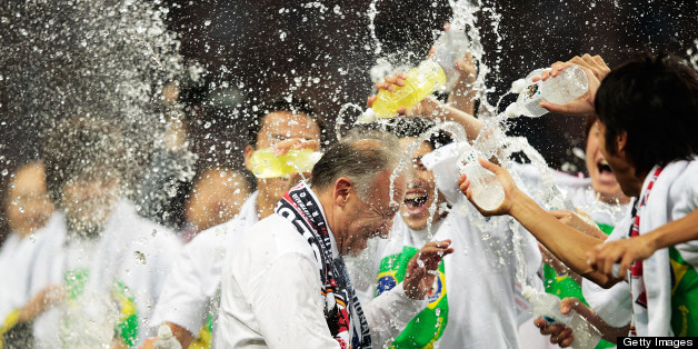 SAITAMA, JAPAN - JUNE 04:  Alberto Zaccheroni Head Coach of Japan is soaked by players after the FIFA World Cup qualifier match between Japan and Australia at Saitama Stadium on June 4, 2013 in Saitama, Japan.  (Photo by Adam Pretty/Getty Images)