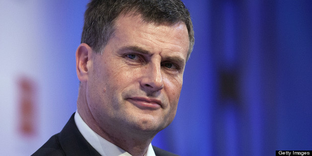 Ronan Dunne, chief executive officer of Telefonica SA's U.K. unit, listens to a speaker during the Confederation of British Industry (CBI) annual conference at the Grosvenor House hotel in London, U.K., on Monday, Nov. 19, 2012. U.K. Prime Minister David Cameron said he plans to make it harder to apply for judge-led reviews of government decisions in the U.K., arguing the current system and other red tape are holding back projects needed to boost growth. Photographer: Simon Dawson/Bloomberg via Getty Images