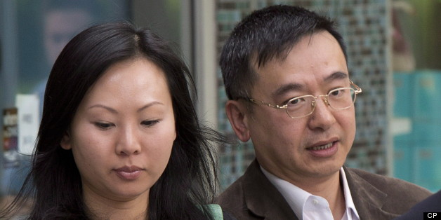 Franco Yui Kwan Orr and his partner Oi Ling Nicole Huen arrive at the B.C. Supreme court in downtown Vancouver, B.C. on May 30. The couple are accused of not paying a nanny for four years of work. (THE CANADIAN PRESS/Jonathan Hayward)