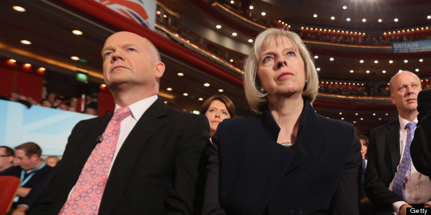 BIRMINGHAM, ENGLAND - OCTOBER 10: Foreign Secretary William Hague (L), Home Secretary Theresa May (C) and Health Secretary Jeremy Hunt (R) watch British Prime Minister David Cameron, delivers his speech to delegates on the last day of the Conservative party conference in the International Convention Centre on October 10, 2012 in Birmingham, England. In his speech to close the annual, four-day Conservative party conference, Cameron stated 'I'm not here to defend priviledge, I'm here to spread it'.  (Photo by Oli Scarff/Getty Images)