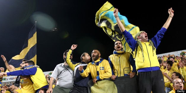 AEL Limassol's fans cheer for their team before the start of the UEFA Europa League group C football match between AEL Limassol and Fenerbahce at GSP Stadium in the Cypriot capital Nicosia on October 25, 2012. AFP PHOTO / BEHROUZ MEHRI        (Photo credit should read BEHROUZ MEHRI/AFP/Getty Images)