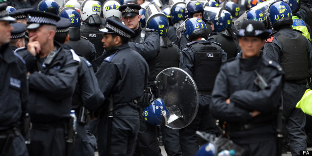 Riot police have lined the streets of central London