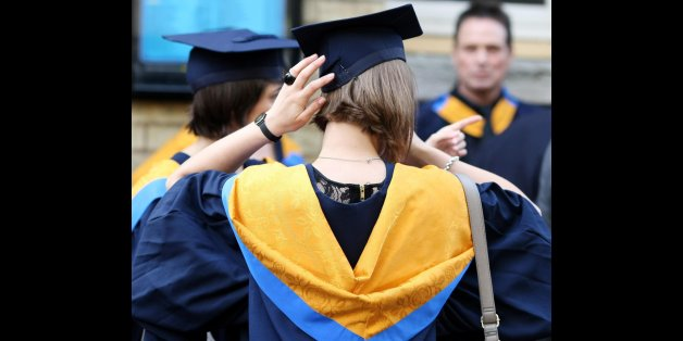 File photo dated 12/10/11 of a general view of students wearing mortar boards and gowns after graduating as university applications have yet to climb back to the levels seen before the tuition fee hike, new data shows.