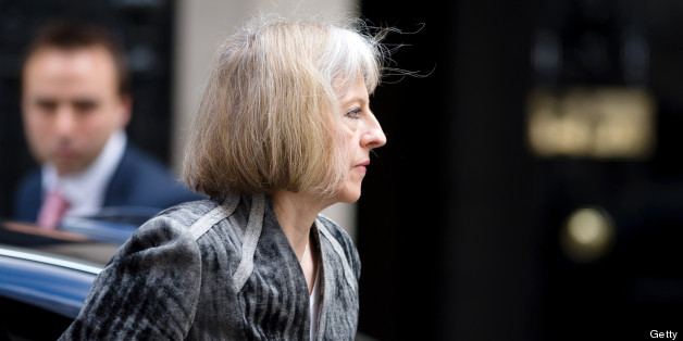 British Home Secretary Theresa May arrives to attend a meeting with government's emergency response committee, COBRA, in Downing Street in central London on May 23, 2013. Britain's national security chiefs were meeting as counter-terrorism police investigated the murder of a soldier who was hacked to death in a London street by two suspected Islamic extremists. AFP PHOTO/Leon Neal        (Photo credit should read LEON NEAL/AFP/Getty Images)